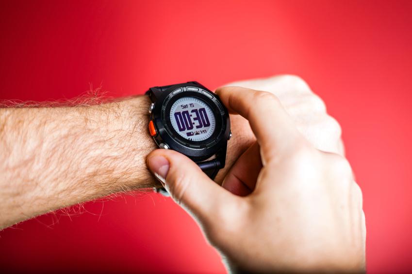 Runner checking sport watch