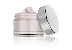 glass jar of beauty cream with cap, isolated